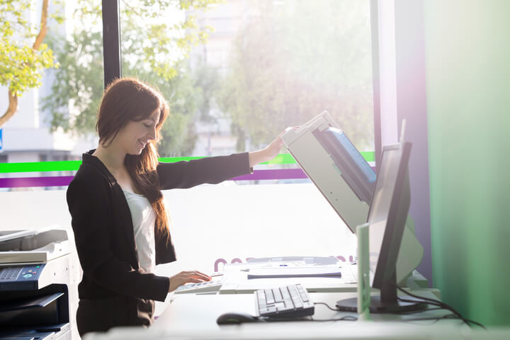 Woman Copying Documents